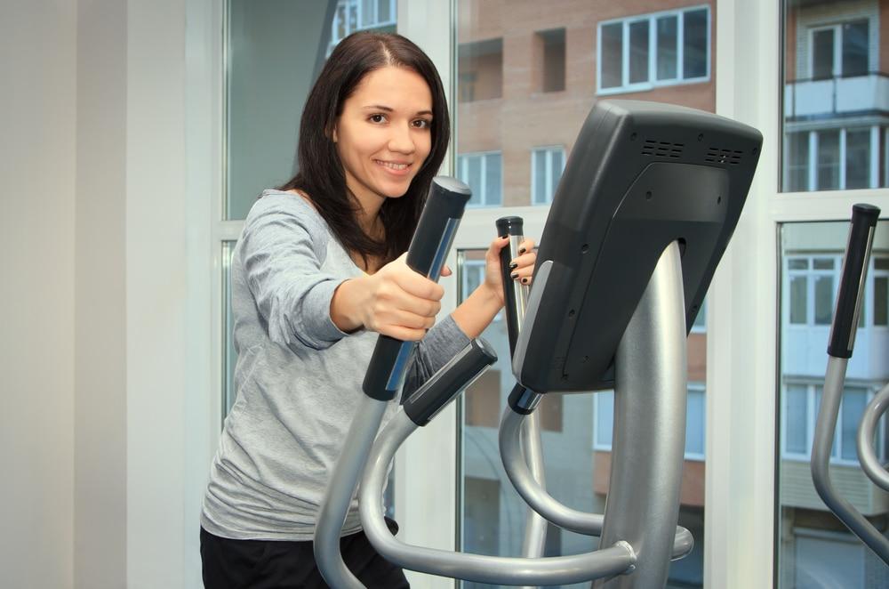 Girl doing exercise on Elliptical Bike - Fitness Expo Stores