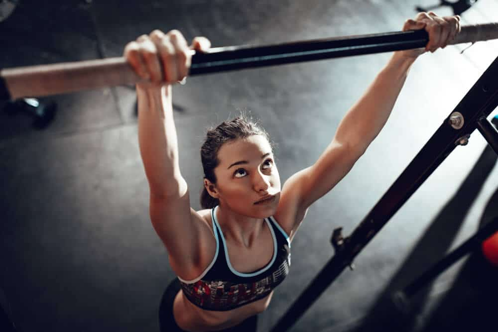 Women Do a Pull-ups exercise | Fitness Expo