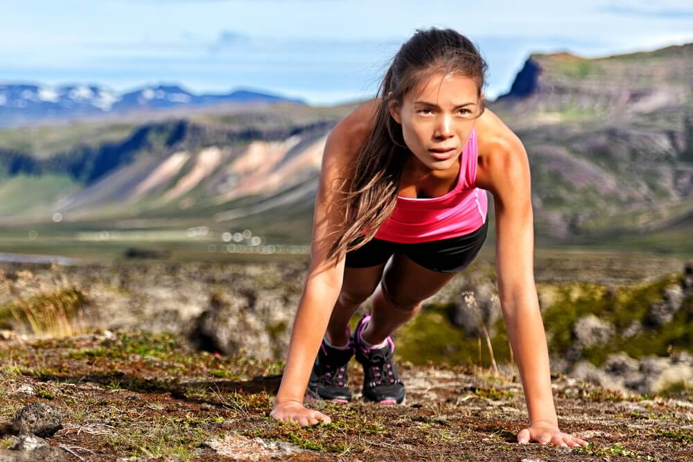 Woman doing pushups outdoors | Fitness Expo