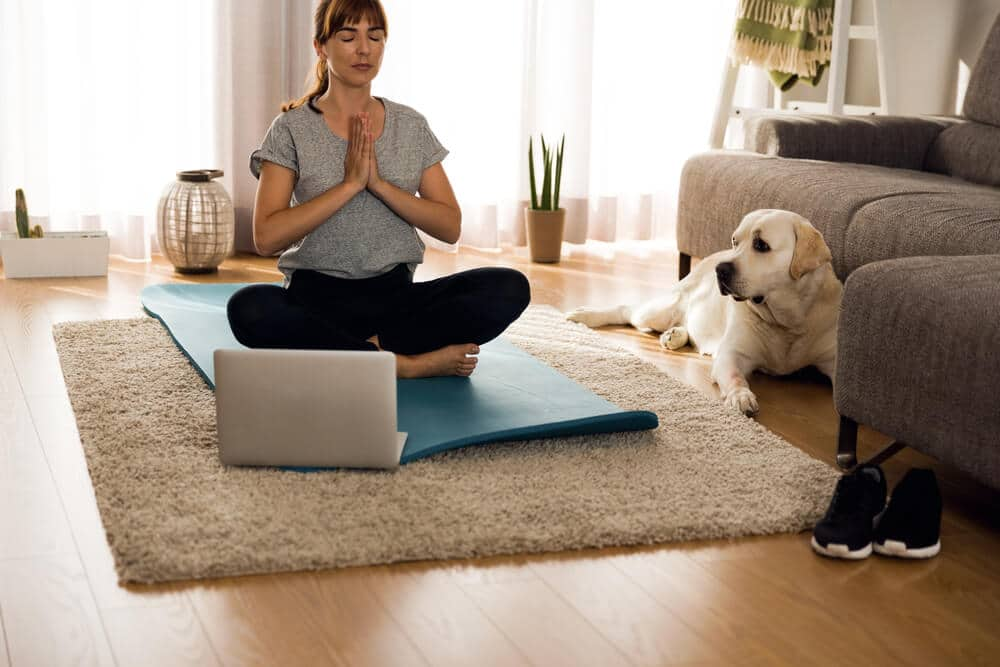 Woman Meditates with Dog| Fitness Expo Stores