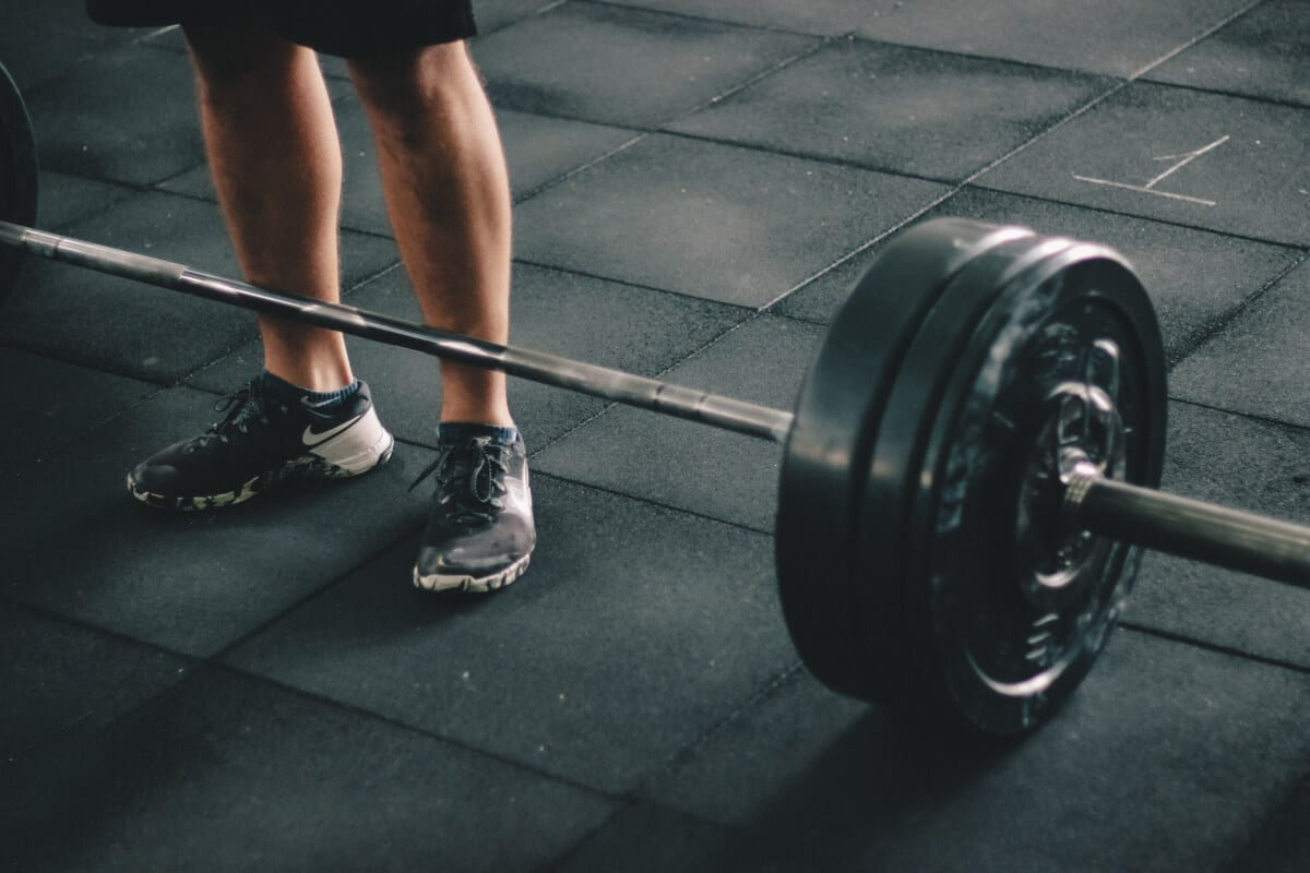 man and a dumbbell | Fitness Expo