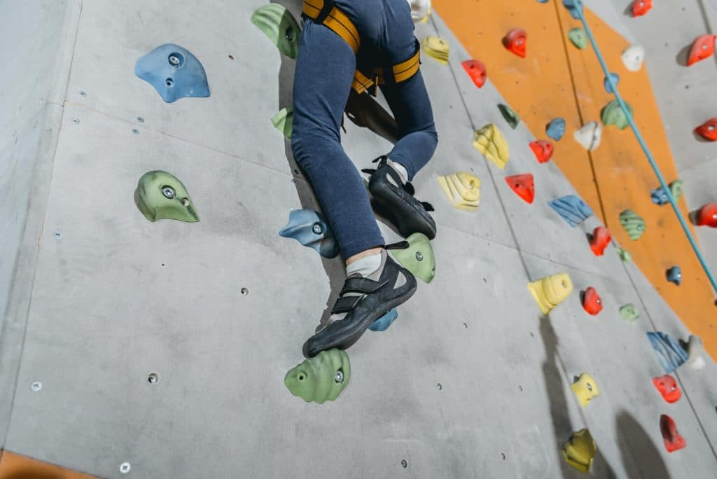 Climbing Gym Walls with Grips and Harness